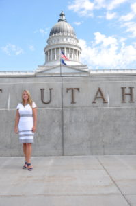 Michele Weeks standing in front of the Utah State Capitol